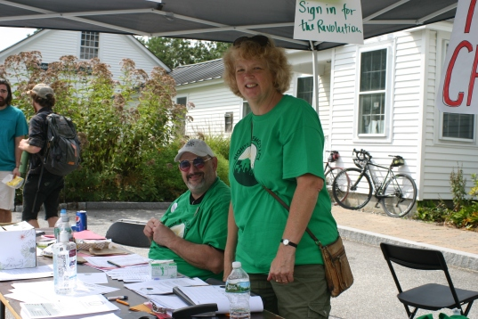 Volunteers manning the sign-in table at the entrance to event.