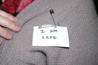 "Participant showing her ""I am safe"" designating her as a safe person to go to if someone feels uncomfortable or harassed."